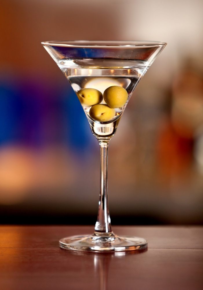 Glass of martini drink with olives ? cocktail concepts